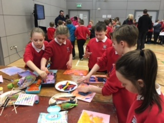 Having fun painting at the Science Show at Foyle Arena.